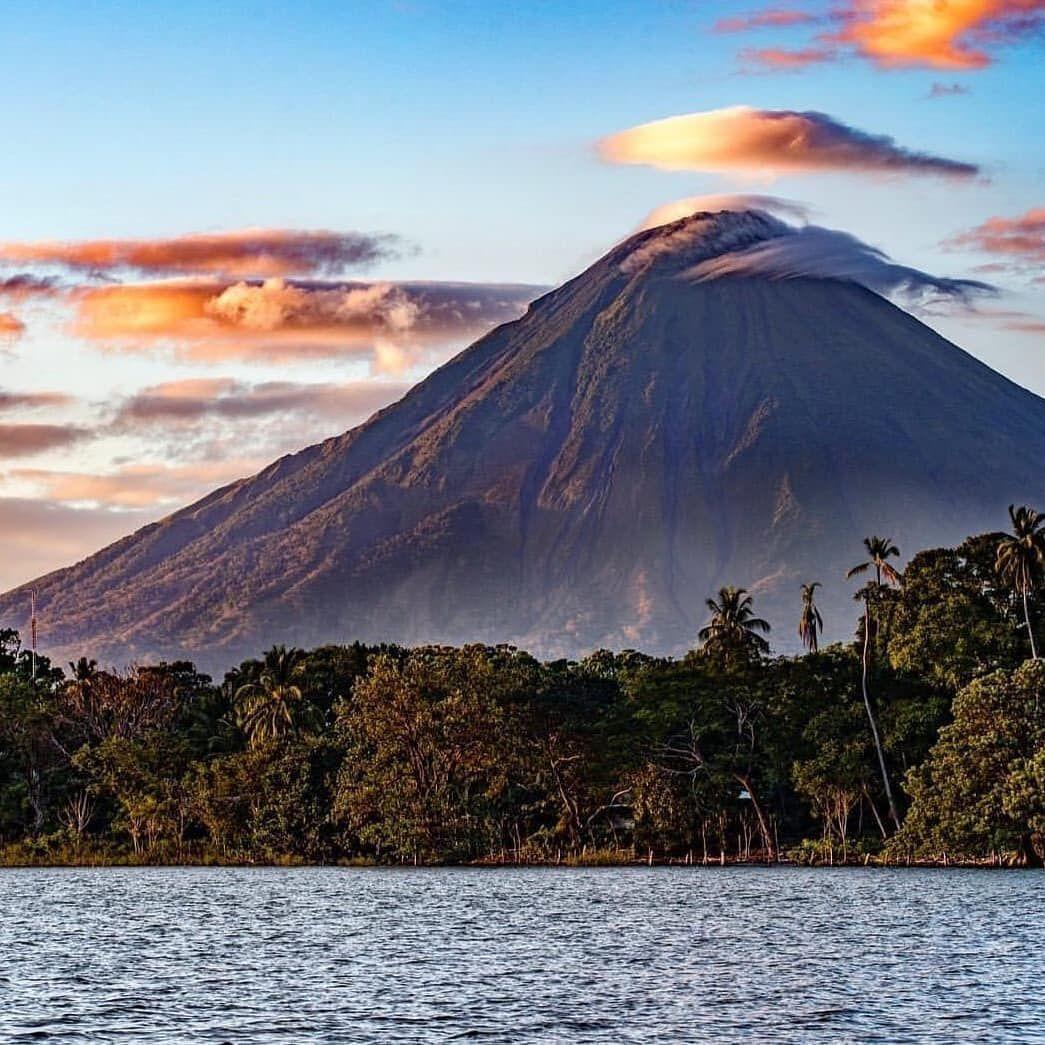 Nicaragua Tour On Instagram Agua Y Fuego El Volcánconcepción Dentro De Las Aguas Del Gran Lago De Nicaragua Natural Landmarks Ometepe Favorite Places