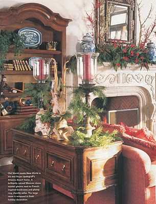 beautiful mantel and sofa table - love the reindeer figurine