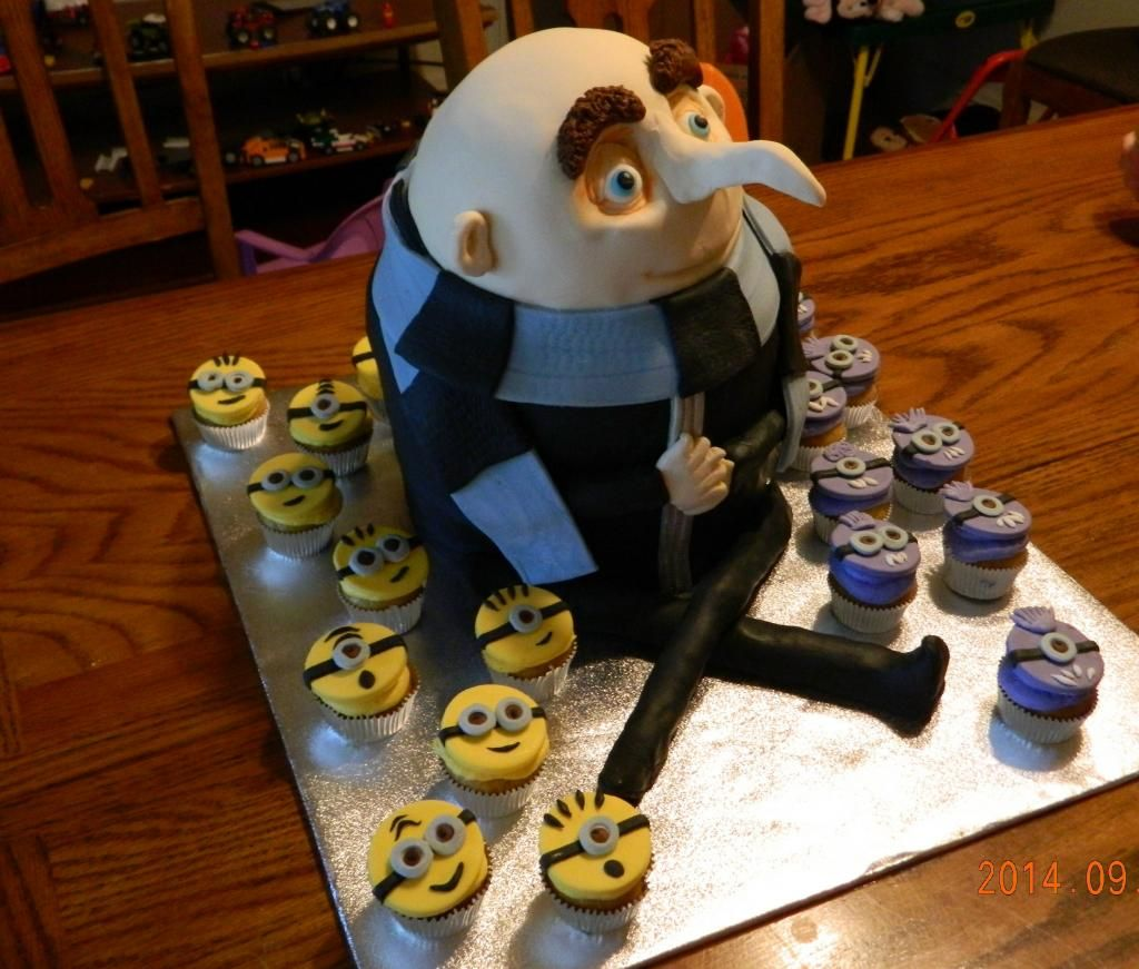 Gru Birthday Cake With Yellow And Purple Minions Cupcakes