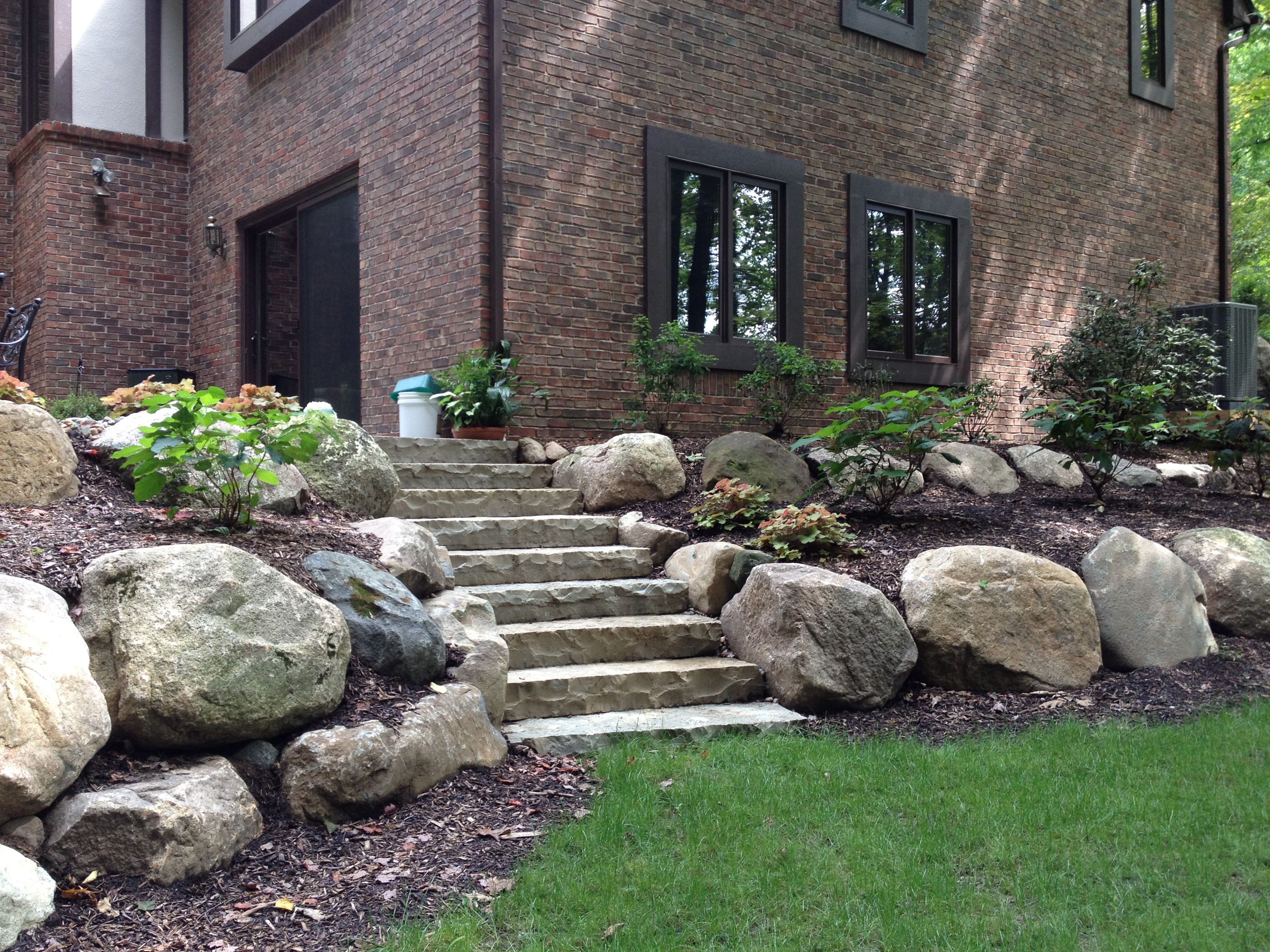 Landscape Design Retaining Wall Ideas luxuriously landscaped terrace garden Boulder Retaining Wall And Limestone Steps For Naturalized Landscape