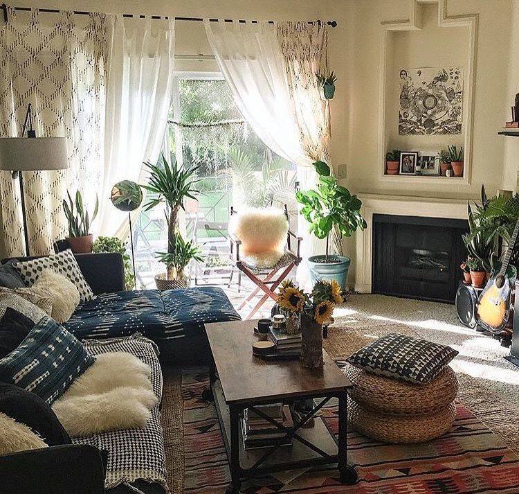 cozy living room ideas  love the plants curtains and tons