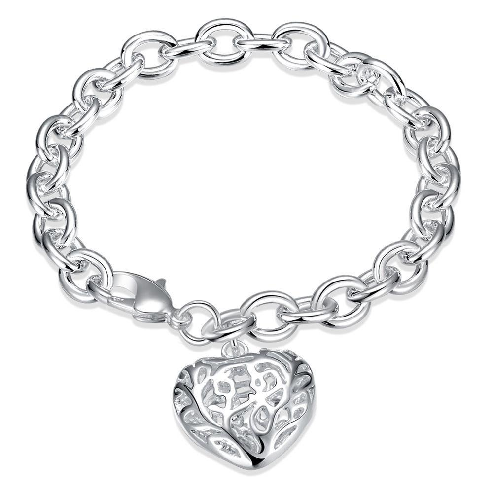 Filigree heart bracelet in k white gold plated cage essentials