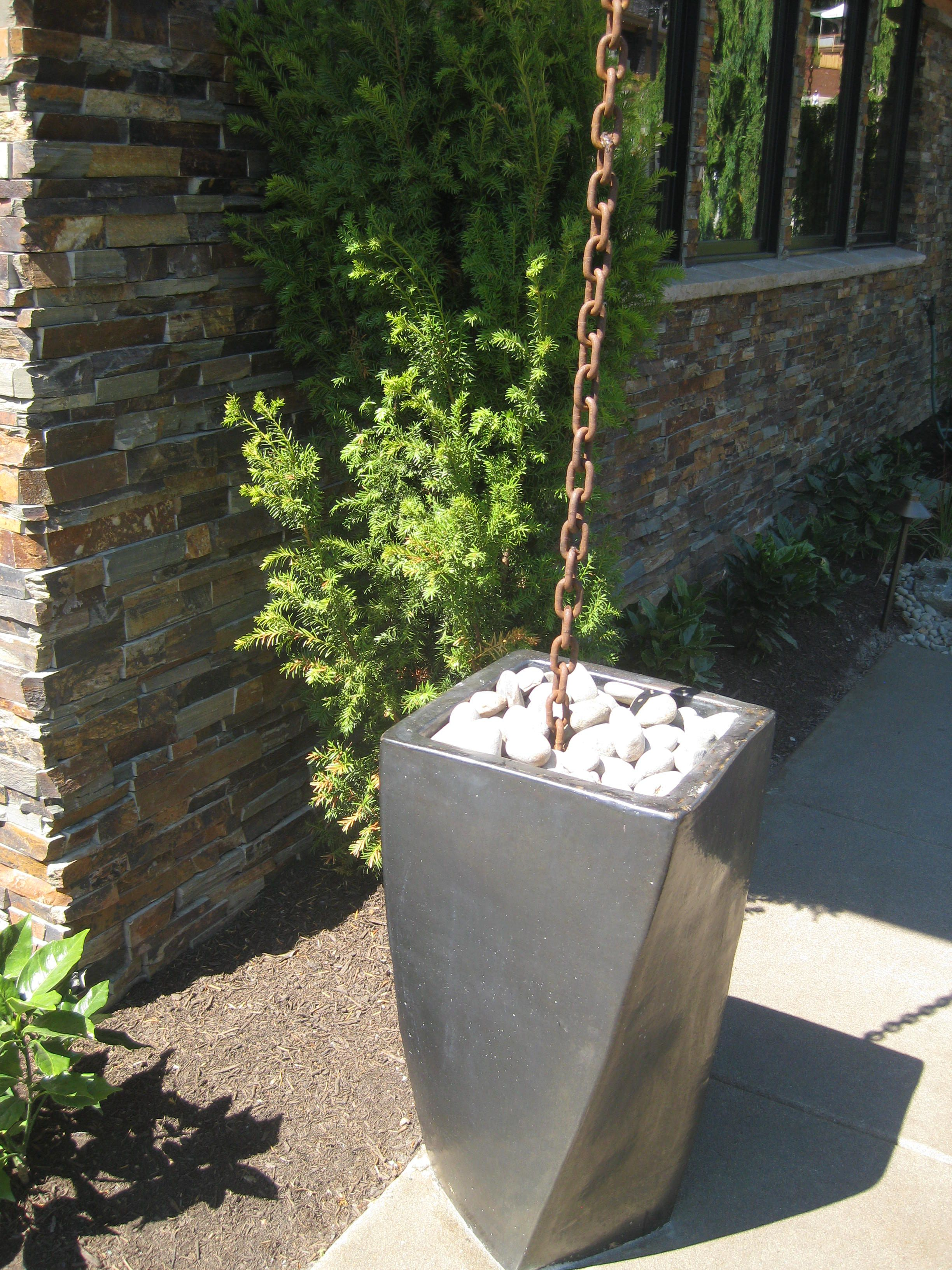 Chain gutter downspout into planter rain barrel home for Downspout drain