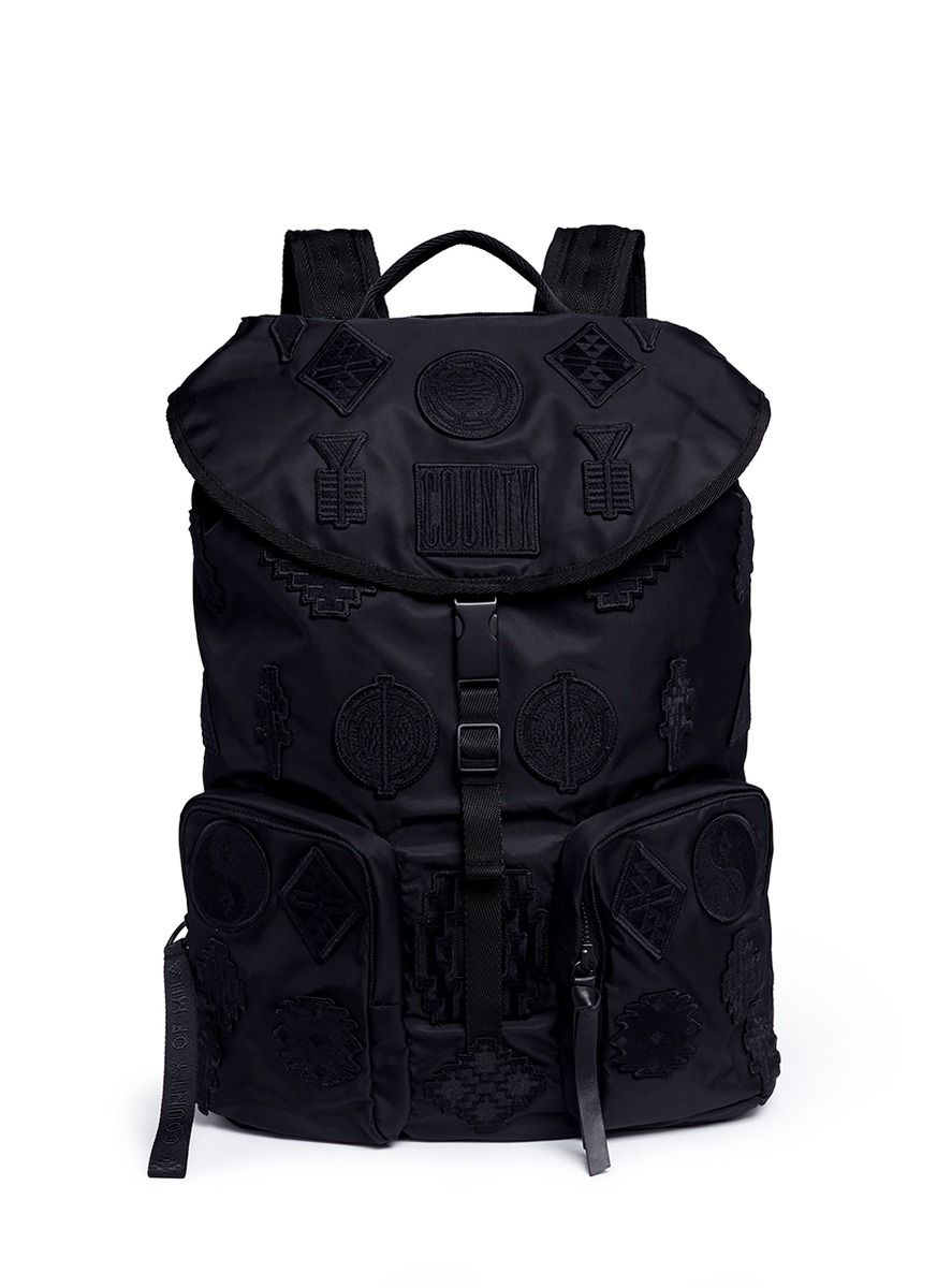 MARCELO BURLON ''Pissis' Icon Patch Backpack. #marceloburlon #bags #lining #nylon #backpacks #