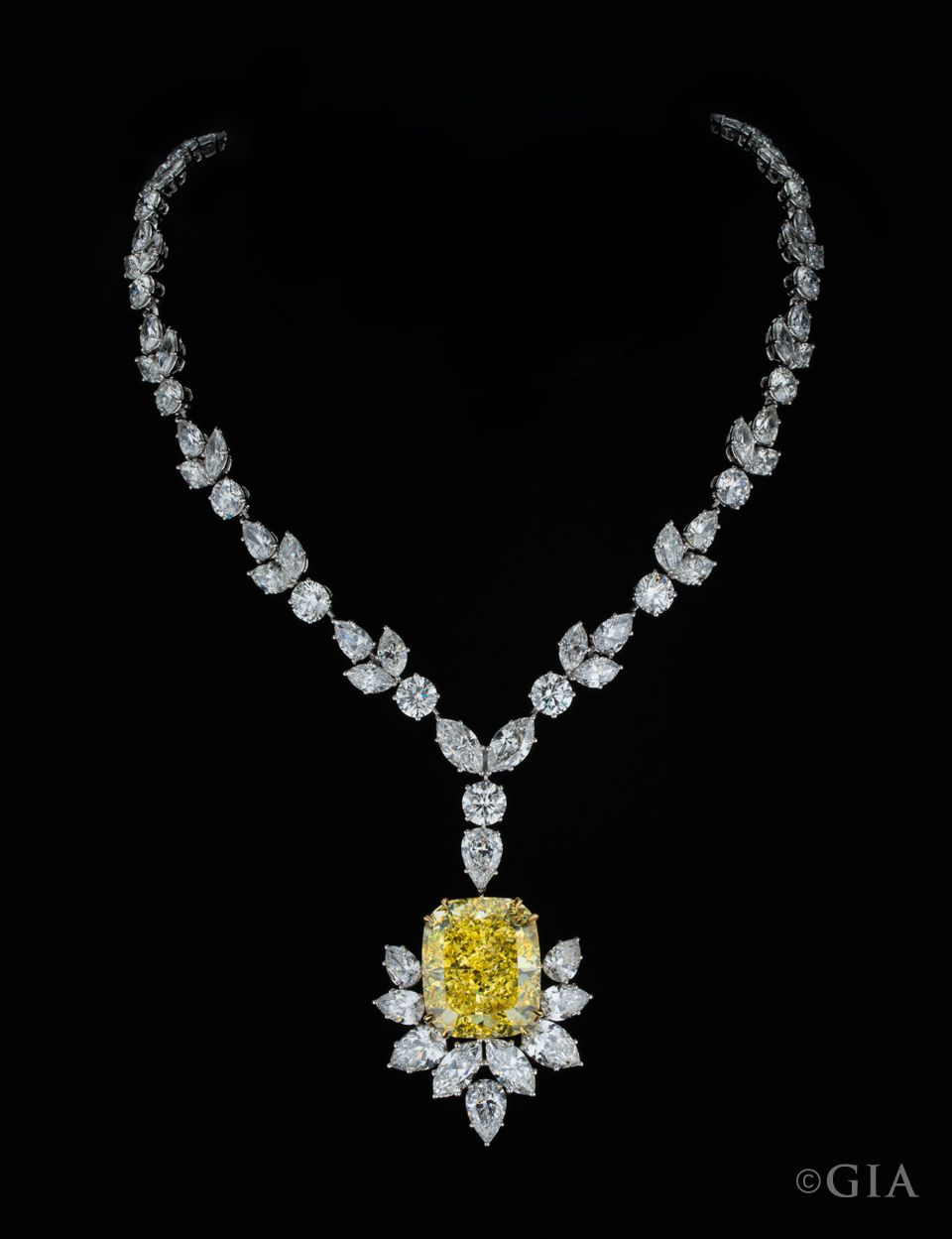 A 54 29 Ct Fancy Intense Yellow Diamond Suspended From A