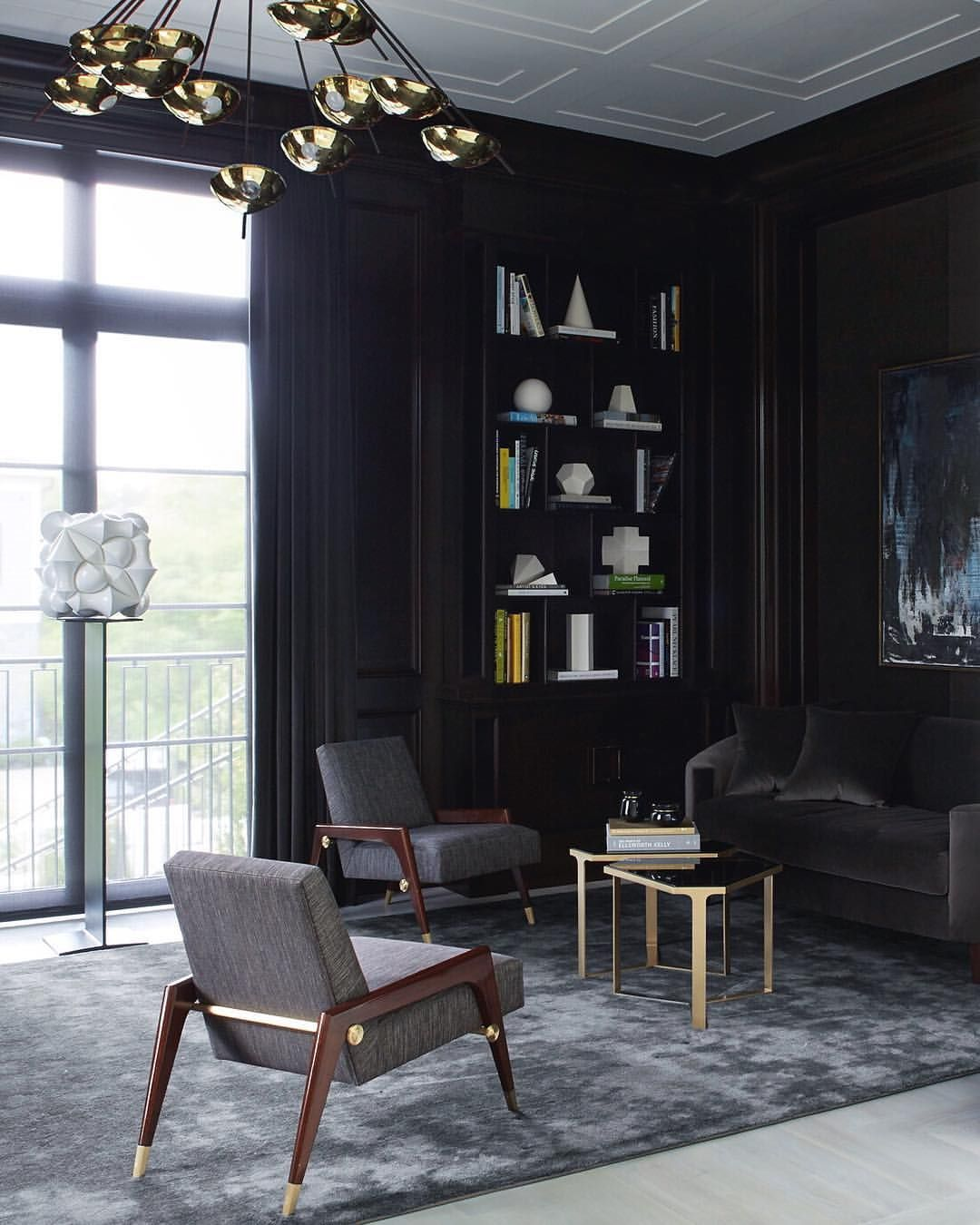 Black Magic- Ebonized mahogany paneling sets the perfect background for this modern library