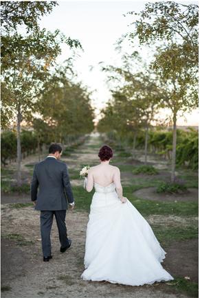Jennifer and Zachary walking into the sunset.  Jacuzzi Vineyards wedding in Sonoma, CA