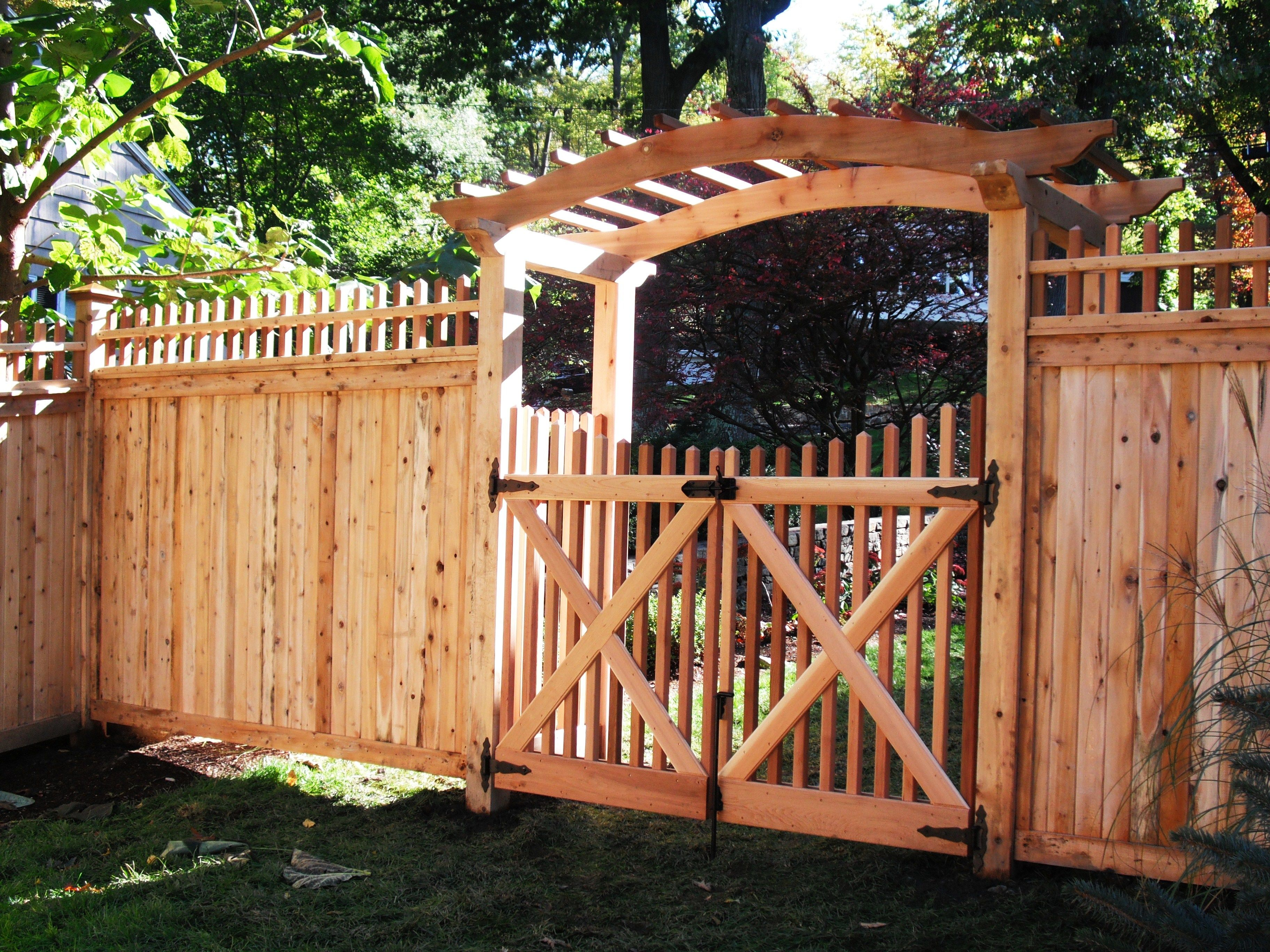 wood arched top pergola with spindle gates yard furnishings