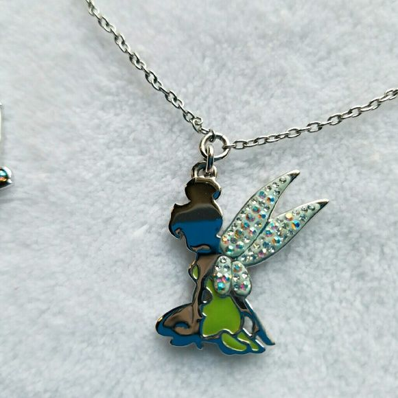 94e834d94 Swarovski Disney Tinkerbell Necklace/Earrings Swarovski Tinkerbell Necklace  w/ Fairy wing Earrings Perfect for any Tinkerbell fan. Swarovski Jewelry