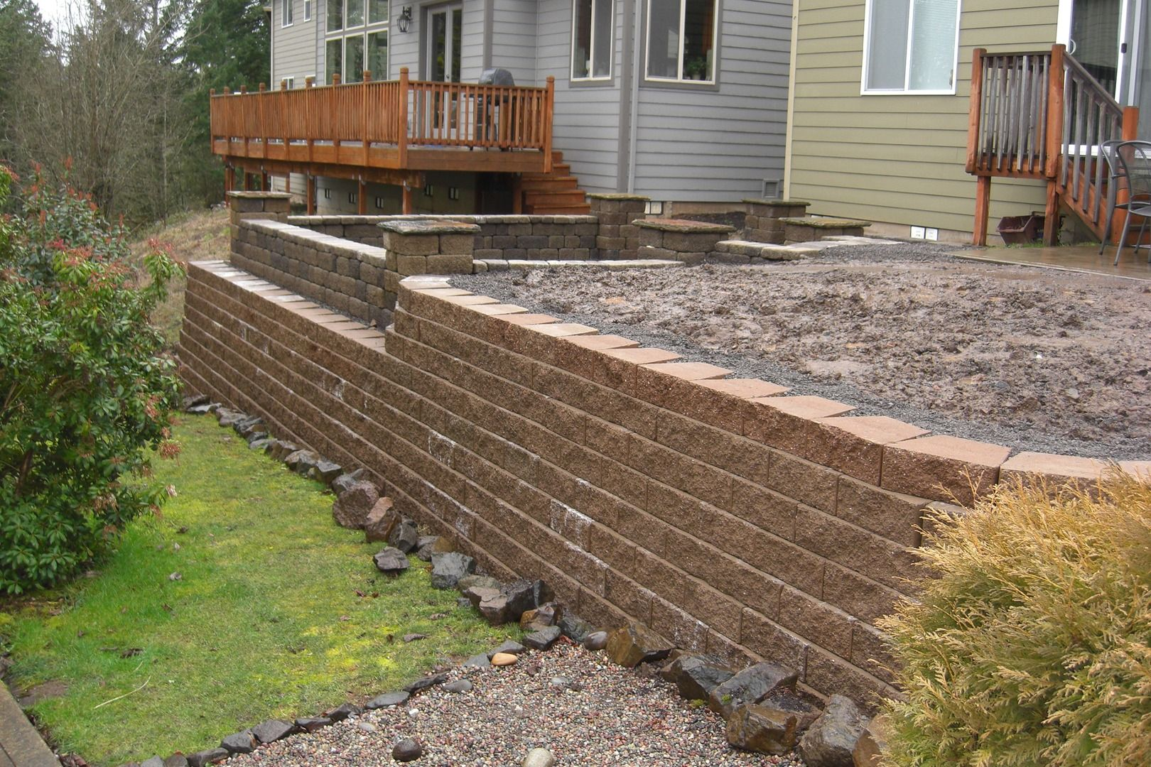 Specialists Landscaping Services Retaining Walls Sprinkler Systems Paver Patios Yard Retaining Wall Design Brick House Designs Landscaping Retaining Walls
