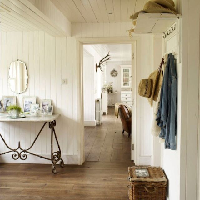 Reclaimed Wood Floors And White Wall Paneling