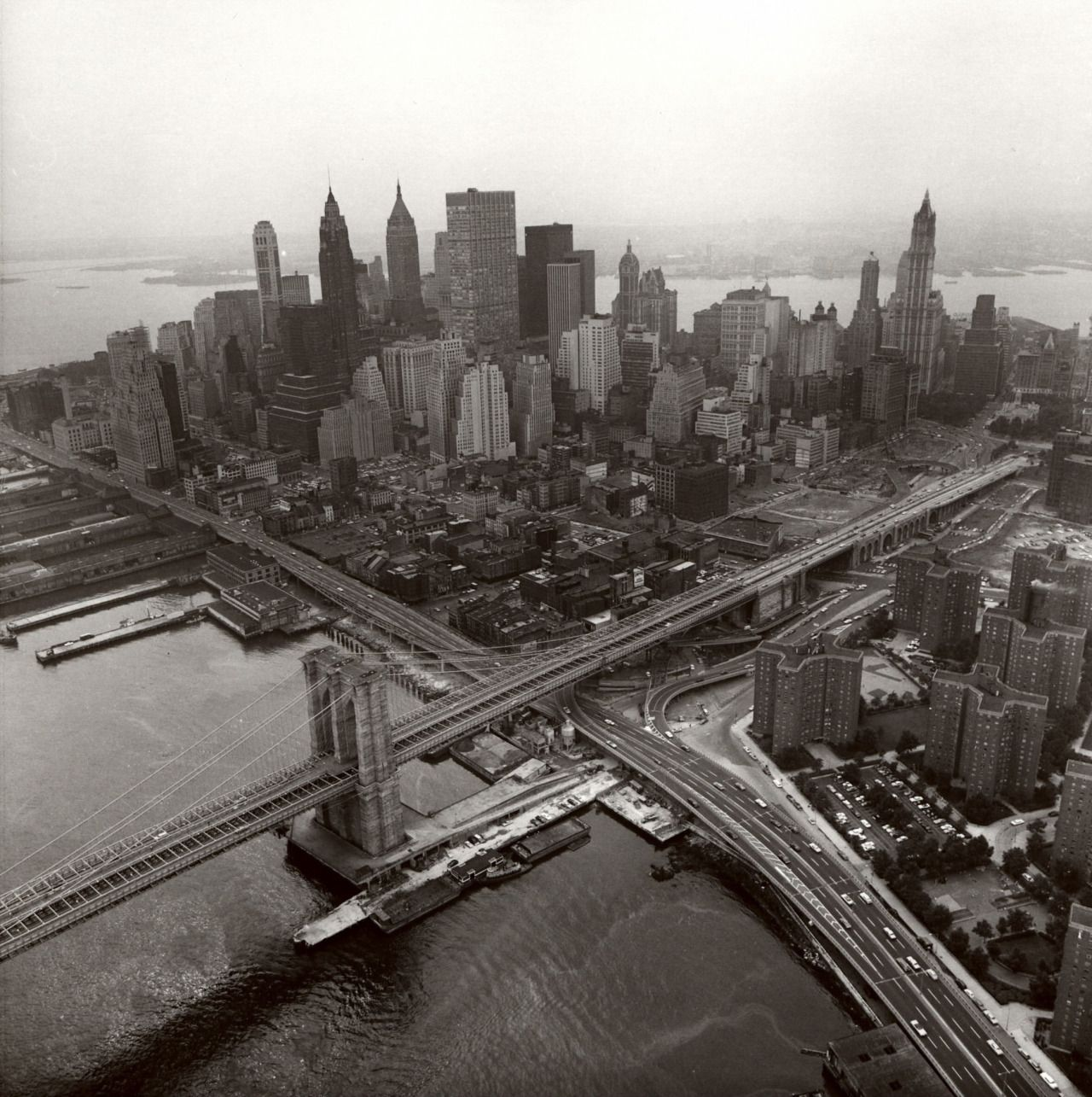""""""" Danny Lyon (American, b. 1942) Lower Manhattan and the Brooklyn Bridge from above the East River, 1967 ©Danny Lyon/Courtesy of Edwynn Houk Gallery Danny Lyon: Murals and Montages opens..."""