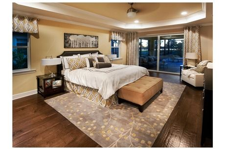 rug under bed hardwood floor. Wonderful Hardwood Yellow And Gold Complement The Rustic Hardwood Floors In A Bedroom That  Opens To Covered Rustic Hardwood FloorsRug Under BedPulte  Intended Rug Bed Floor
