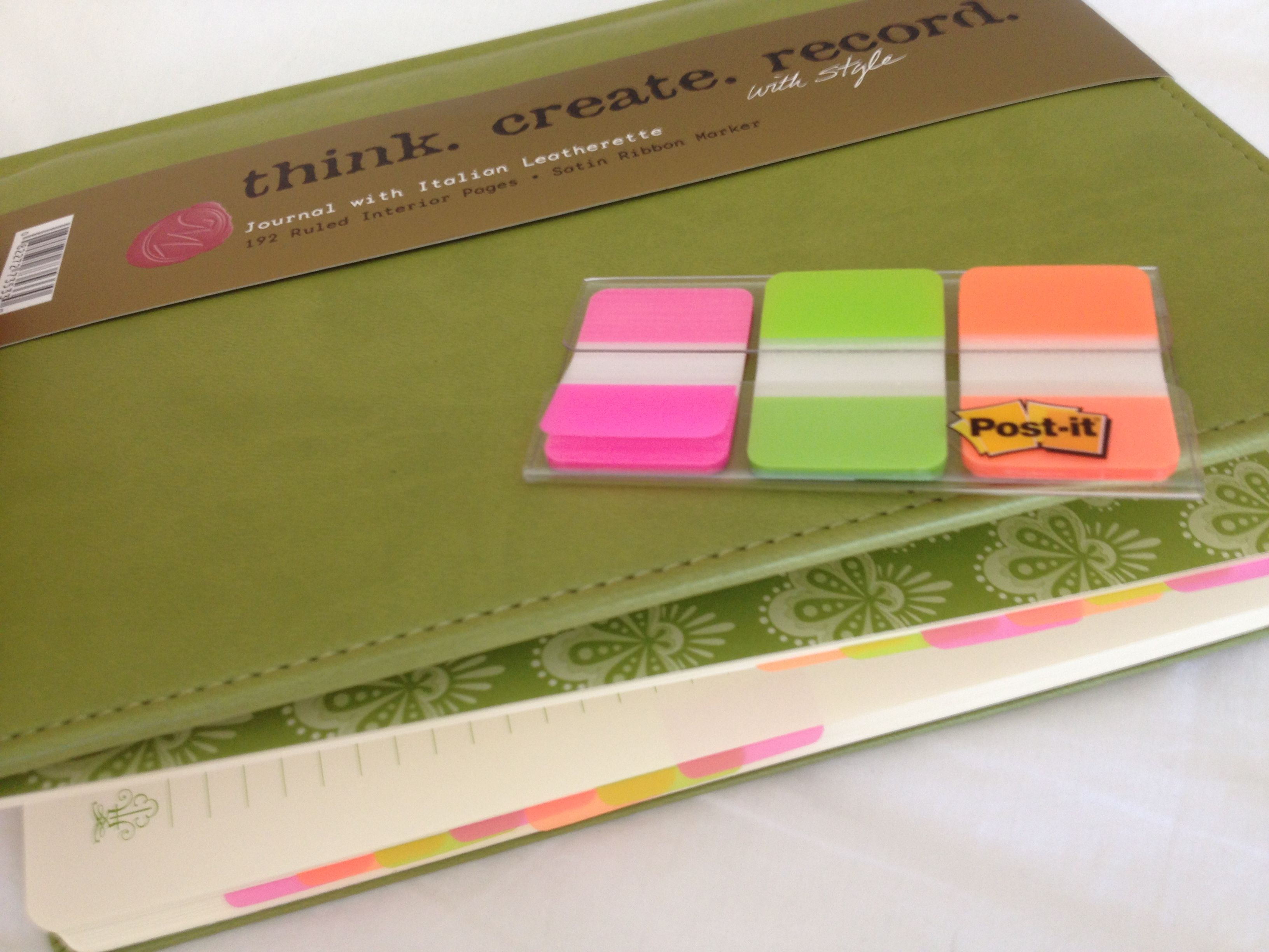 DIY phone book. Much cheaper ($7 journal + $7 Post It tabs vs. $22 for Staples phone book) and cuter! :)
