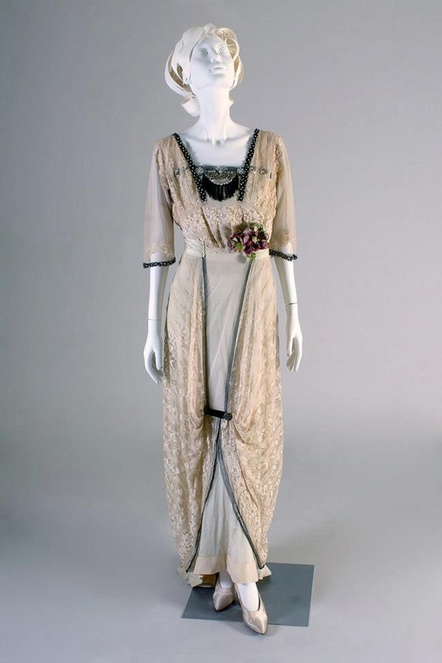 1912, probably France - Dress of pale green silk and machine lace with velvet rim, rhinestones, black jet, and artificial flowers