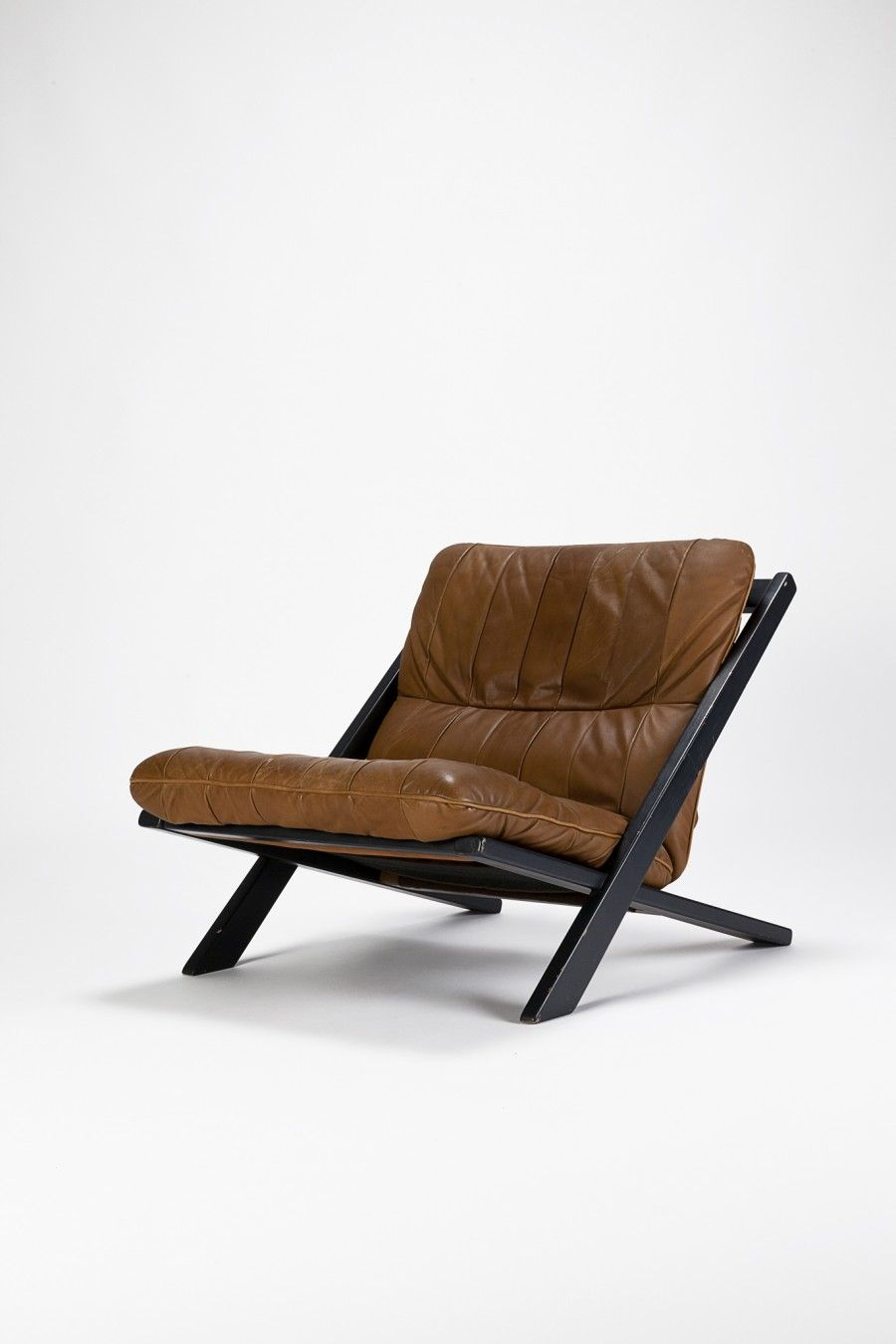 Ueli Berger Attributed; Lacquered Wood and Leather Lounge Chair by De Sede, 1970s.