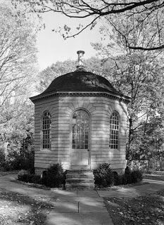 An early survivor is the 1766 summerhouse from the garden of Abraham Redwood in Newport RI, erected long before that seaport city became the most luxurious resort of the gilded age. In the 19th century, it was moved to the grounds of the exquisite Palladian library that he endowed in the mid-18th century, the first library in America. The chaste octagonal facade is of wood, rusticated and surfaced with sand in the paint to emulate stone.