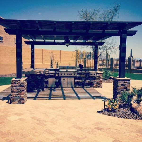 Spanish Brown Color Lattice Pergola Over An Outdoor Kitchen Bbq And Bar Set On Outdoor Kitchen Bars Pergola Covered Patio