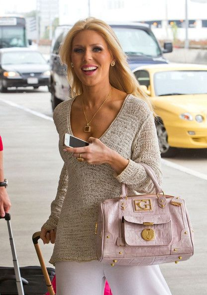 Gretchen Rossi Photo And Slade Smiley At The Airport