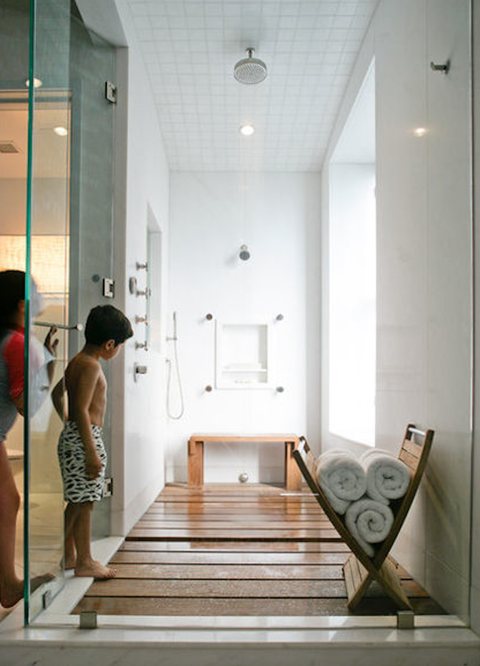 A shower area with ipe flooring designed by Betty ...