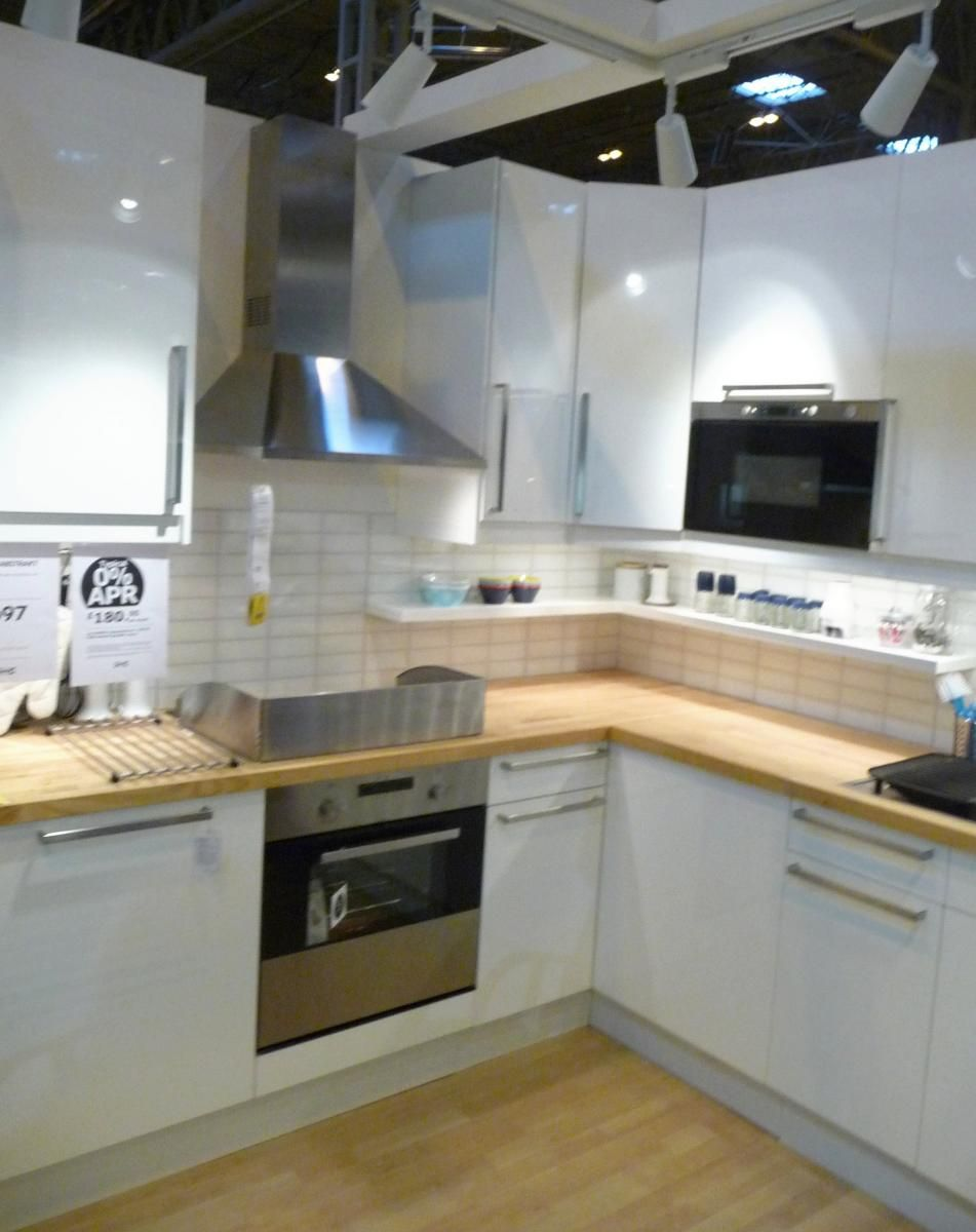 Ikea 39 s abstrakt high gloss white kitchen display at grand for White gloss kitchen wall cupboards