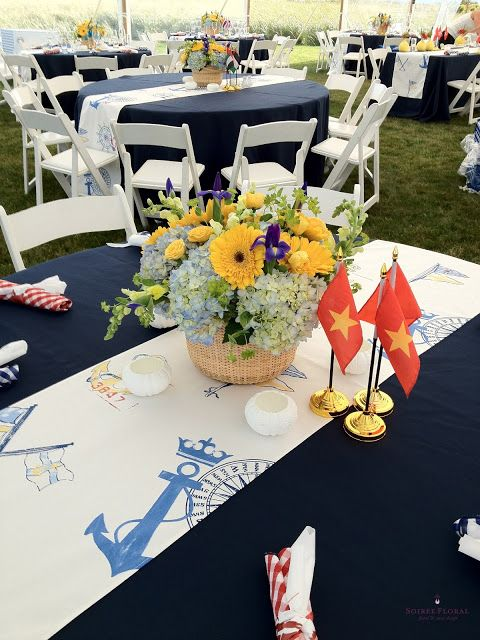 Nautical rehearsal dinner flowers in red, yellow and blue by Soiree Floral