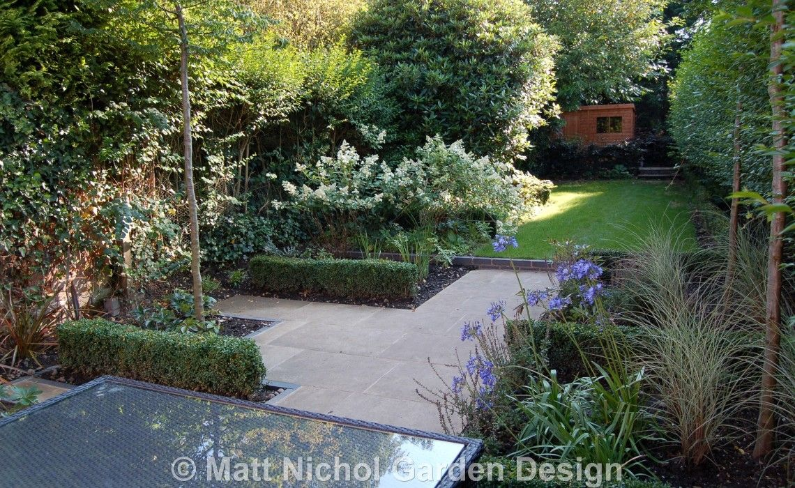 long narrow garden after redesign by matt nichol garden design patio box hedges hydrangea limelight - Garden Ideas Long Narrow