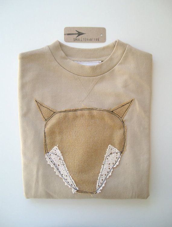 This exclusive appliqued toddler sweater has been freehand machine stitched and features beautiful handcut textures on soft fawn jersey fabric.