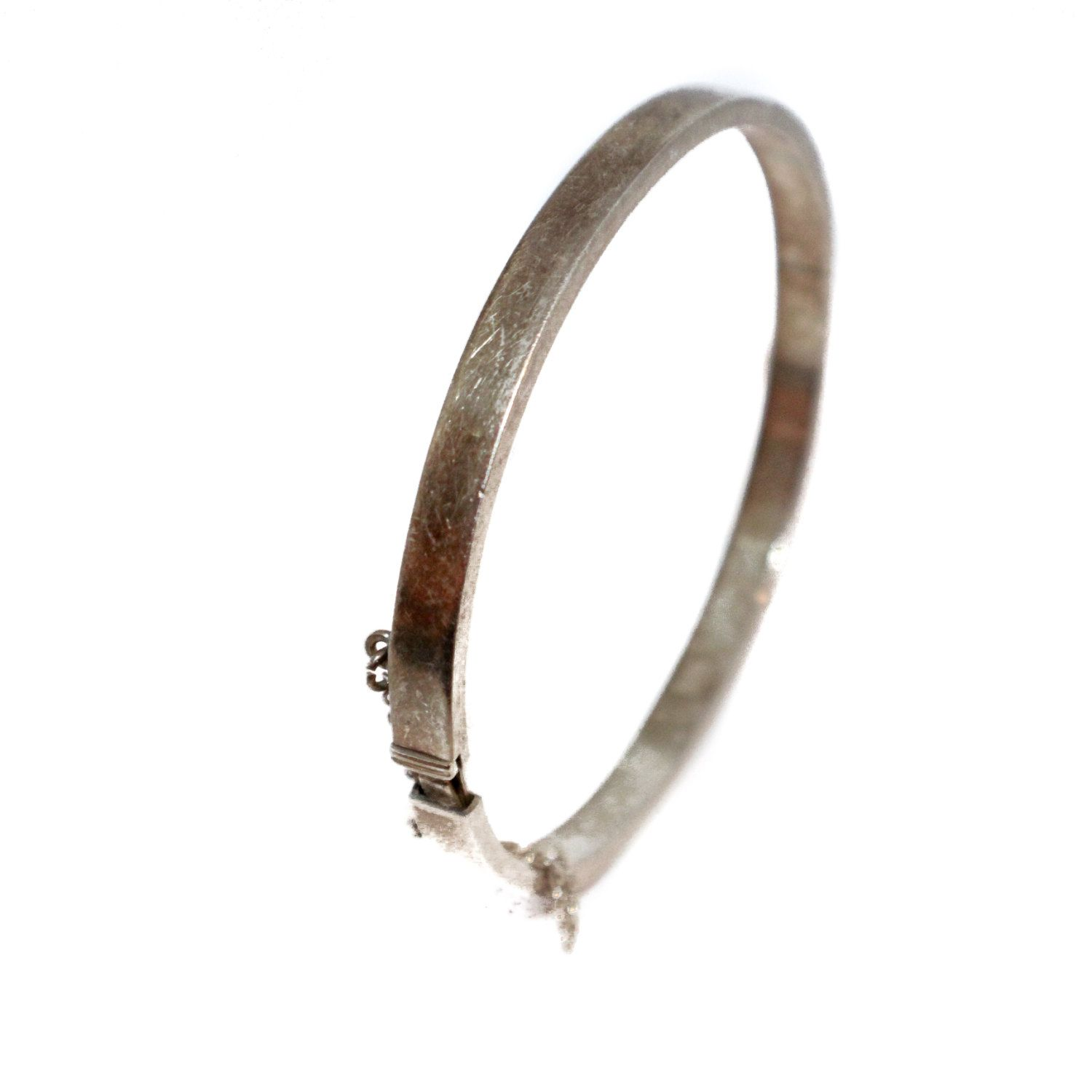 Minimalist sterling silver bangle bracelet with locking clasp and
