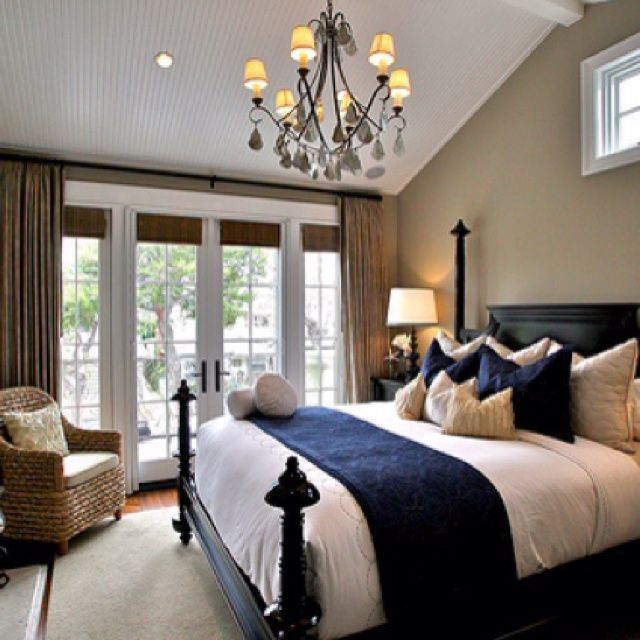 1 Master Bedroom Accented Neutral Shades Of Brown Tan And Eggshell With A Navy Accent