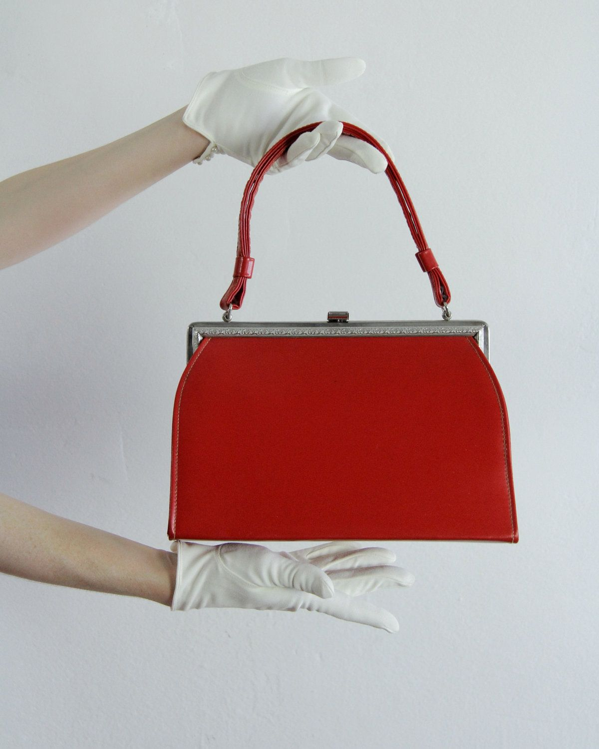 Vintage 60s Purse . Red Vinyl . Vegan . Hand Bag . Silver Metal Frame . 1960s. $45.00, via Etsy.