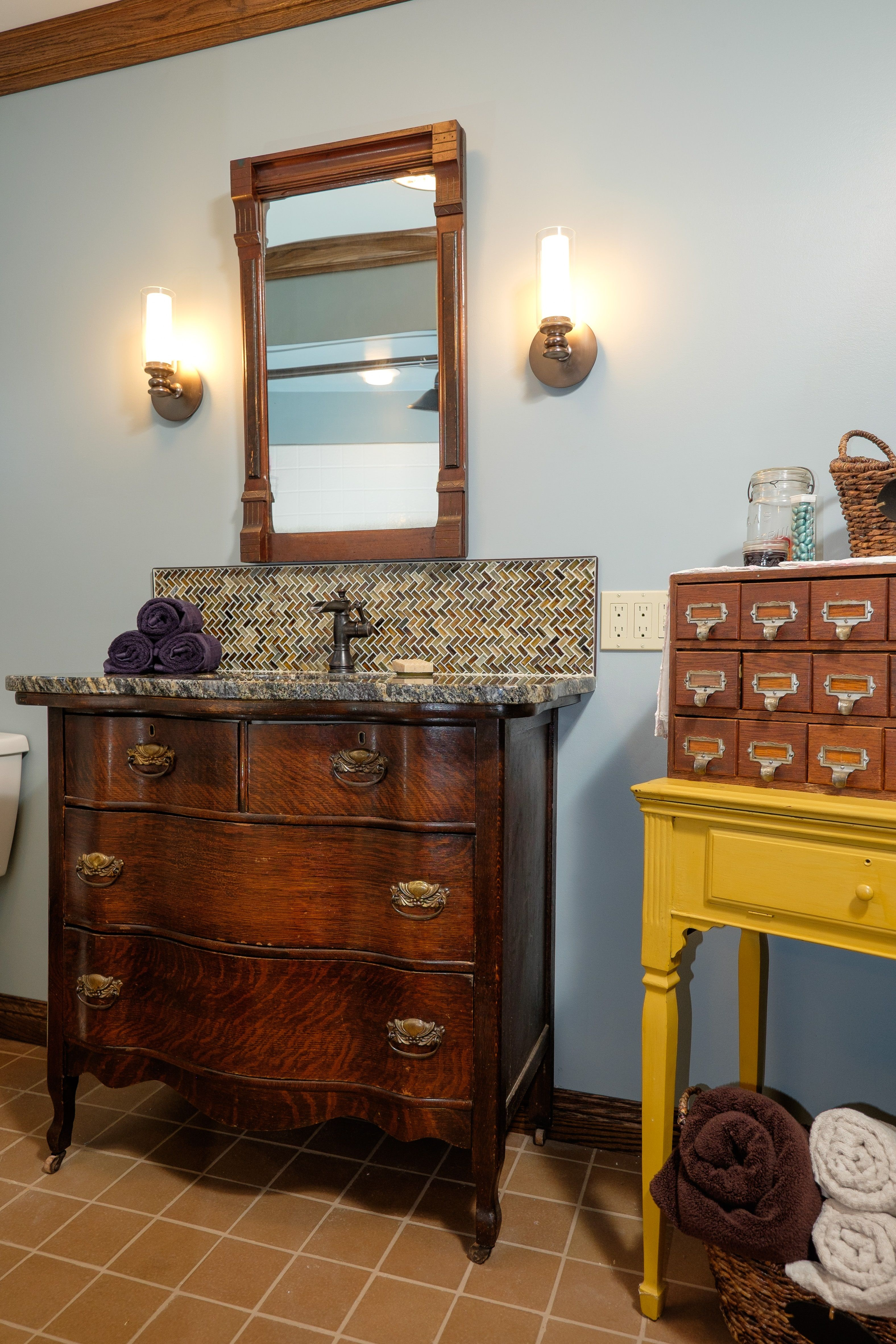 Eclectic antique Master Bathroom with custom fitted antique dresser