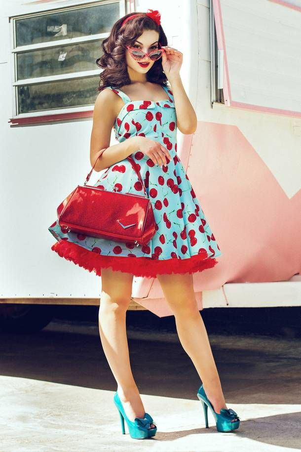 Rockabilly pinup in blue cherry dress with sunglasses Model: Juliann O./TNG Models; Photographer: Ivan Avila; Hair & Makeup by Eden Walton and Candace Campbell/Stone Fox Salon.
