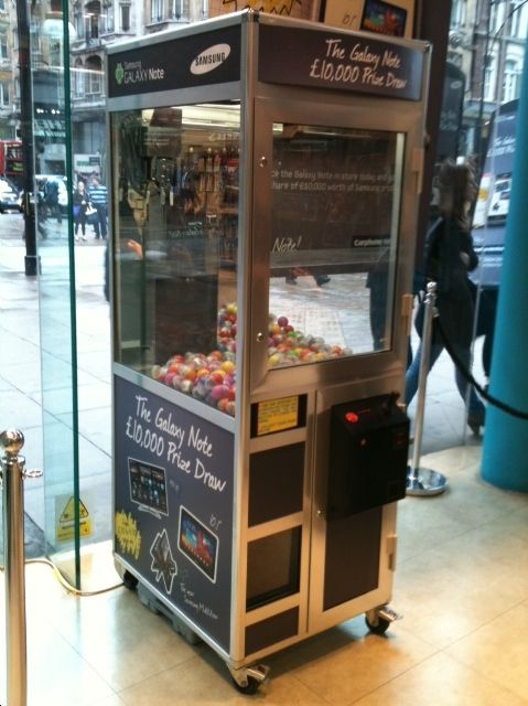 Branded Grabber Machine for hire, your company brand and merchandise up for grabs at your event.