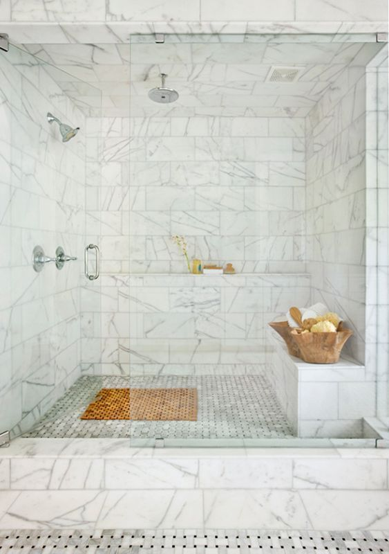 white and gray bathroom with two heads and a cool idea to stow spa supplies! Marble Shower charisma design
