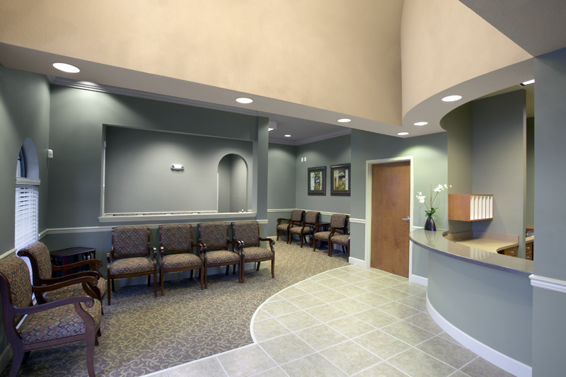 bowed front reception desk in doctors office on blue office color id=82984