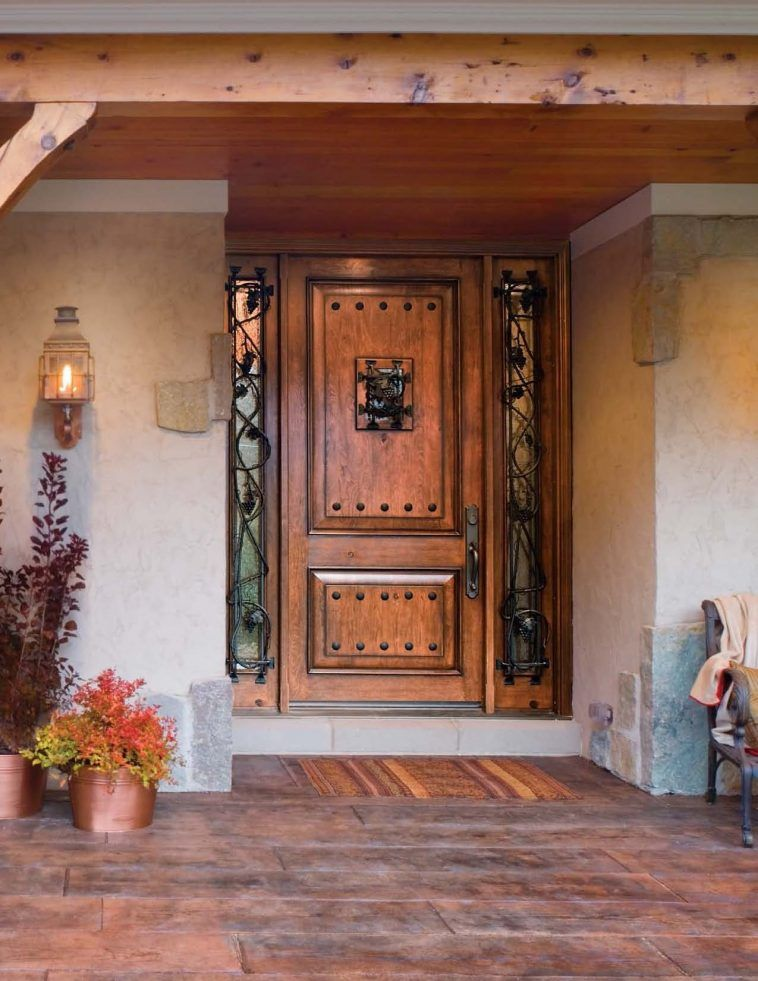 rustic brown lacquered oak wood front door decor with ornate cast iron ornament
