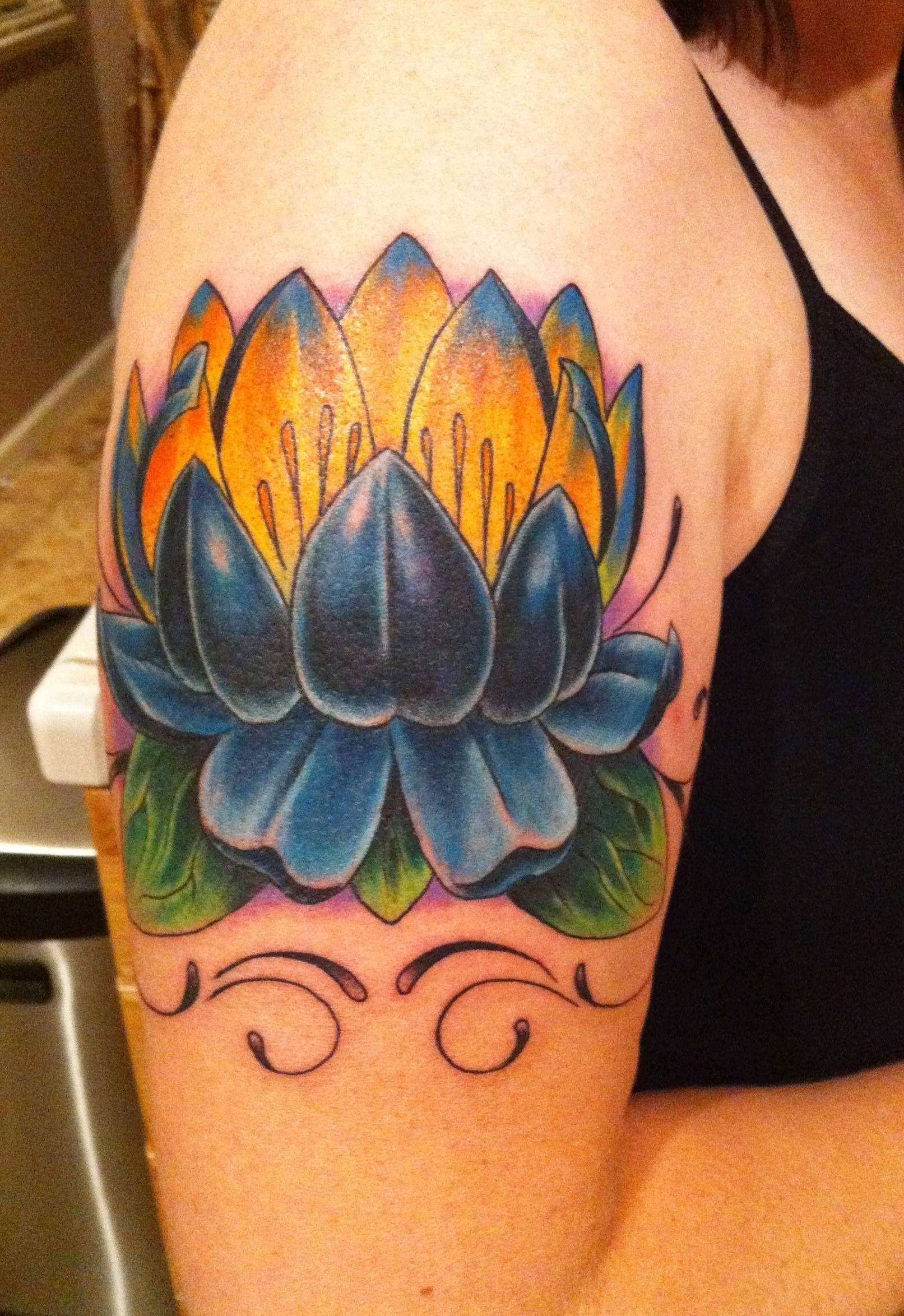 Blue lotus upper arm, very symmetrical Lotus tattoo