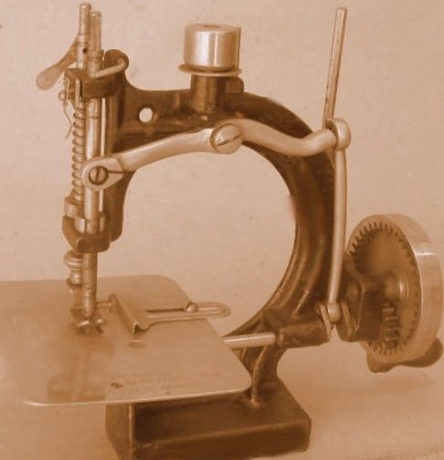 The Spenser sewing machine of Boston Massachusetts patented in June 1900 with patent improvements in Feb 1901 and March 1902