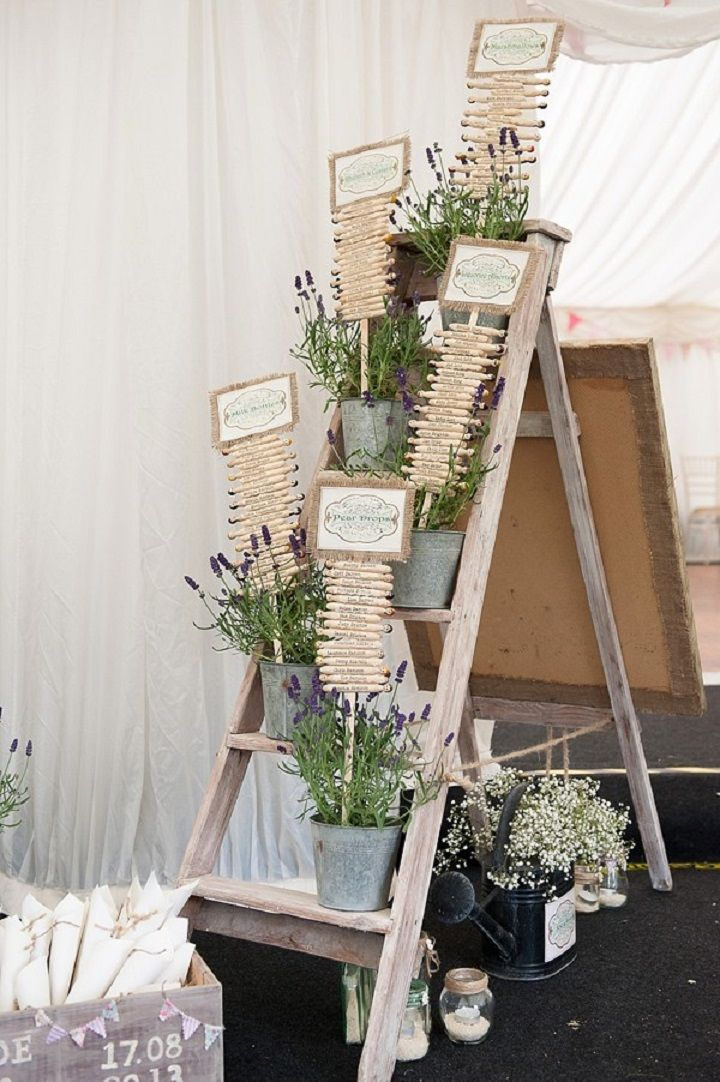 DIY wedding Table plan written on wooden pegs