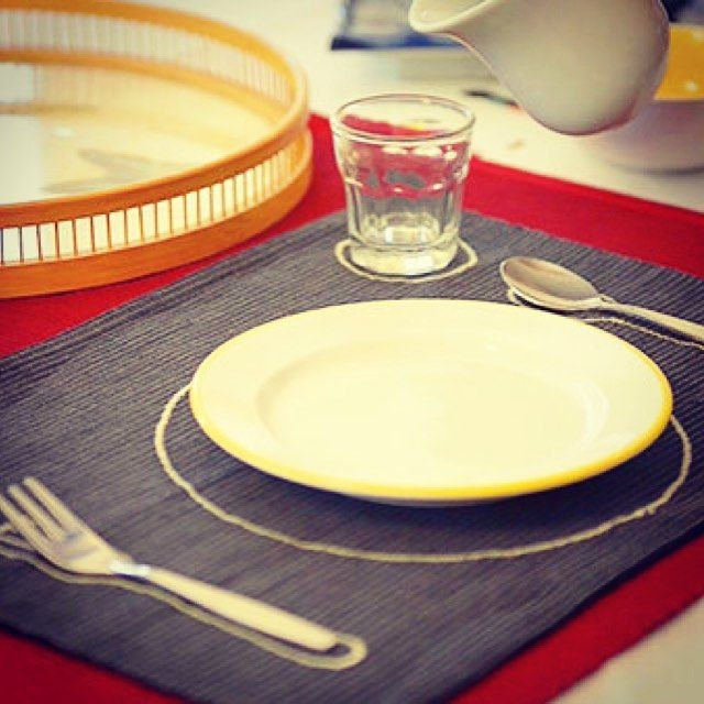 A Montessori cloth placemat provides a road map for a young child during her first mealtime experiences. Real china silverware and glassware allow the child to feel trusted and give a sense of importance to the new experience.  . . . . . . #children #infant #montessorihome #montessoriconsultant #independence #simplicity #naturalmaterial #nobatteries #montessori  #montessorichild #montessoriparent #montessoriinfant #tablemanners