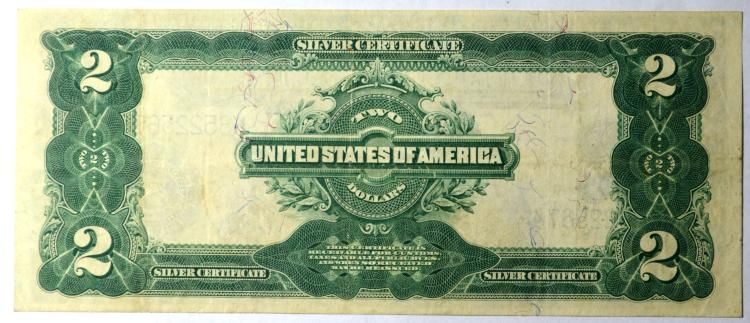 Brightly colored better grade Silver Certificate. Fibers showing on reverse.