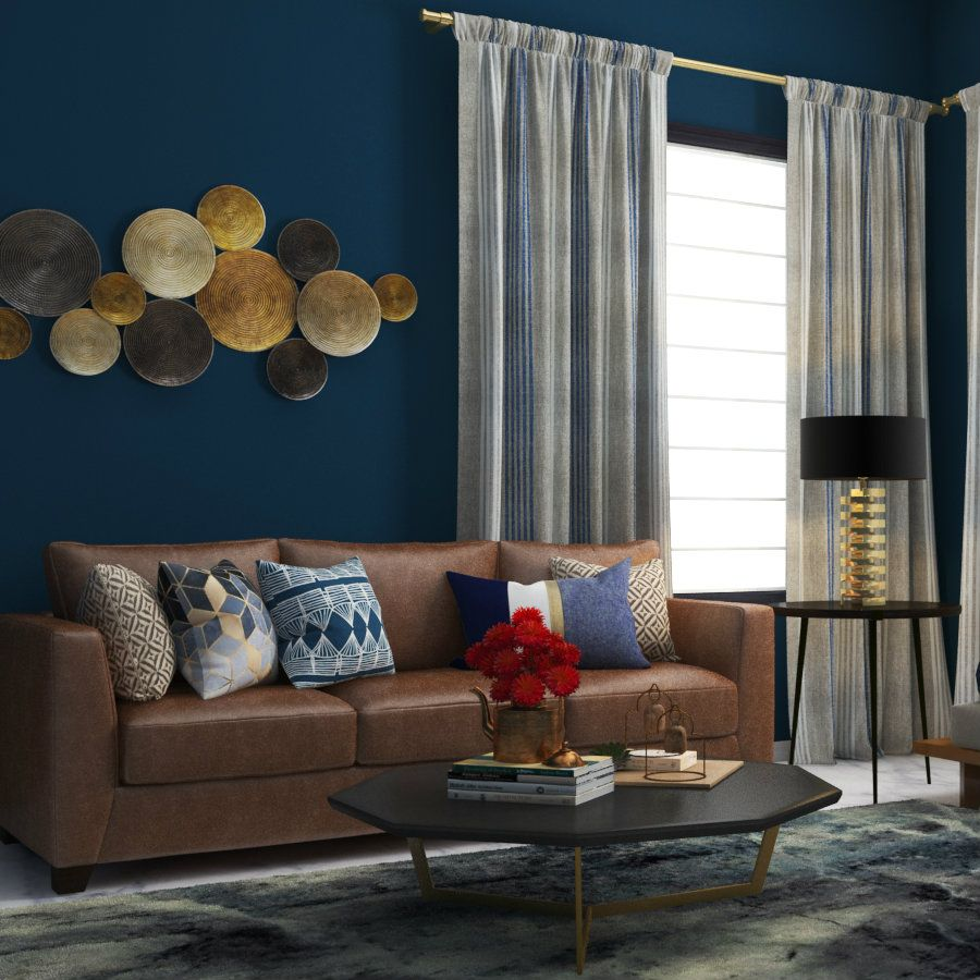 A Navy Blue Wall Matched With A Classic Brown Sofa Brown Living Room Decor Blue Living Room Brown Living Room