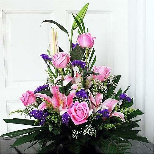 Who says you can't have it all? An arrangement of pink stargazers and roses just to make someone's day. A touch of purple that will truly hold you facinated.