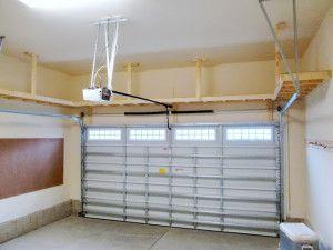 GREAT IDEA - add a big shelf for overhead storage in the garage! A MUST DO project! / www.doorsandmorellc.com 228-872-1122 More
