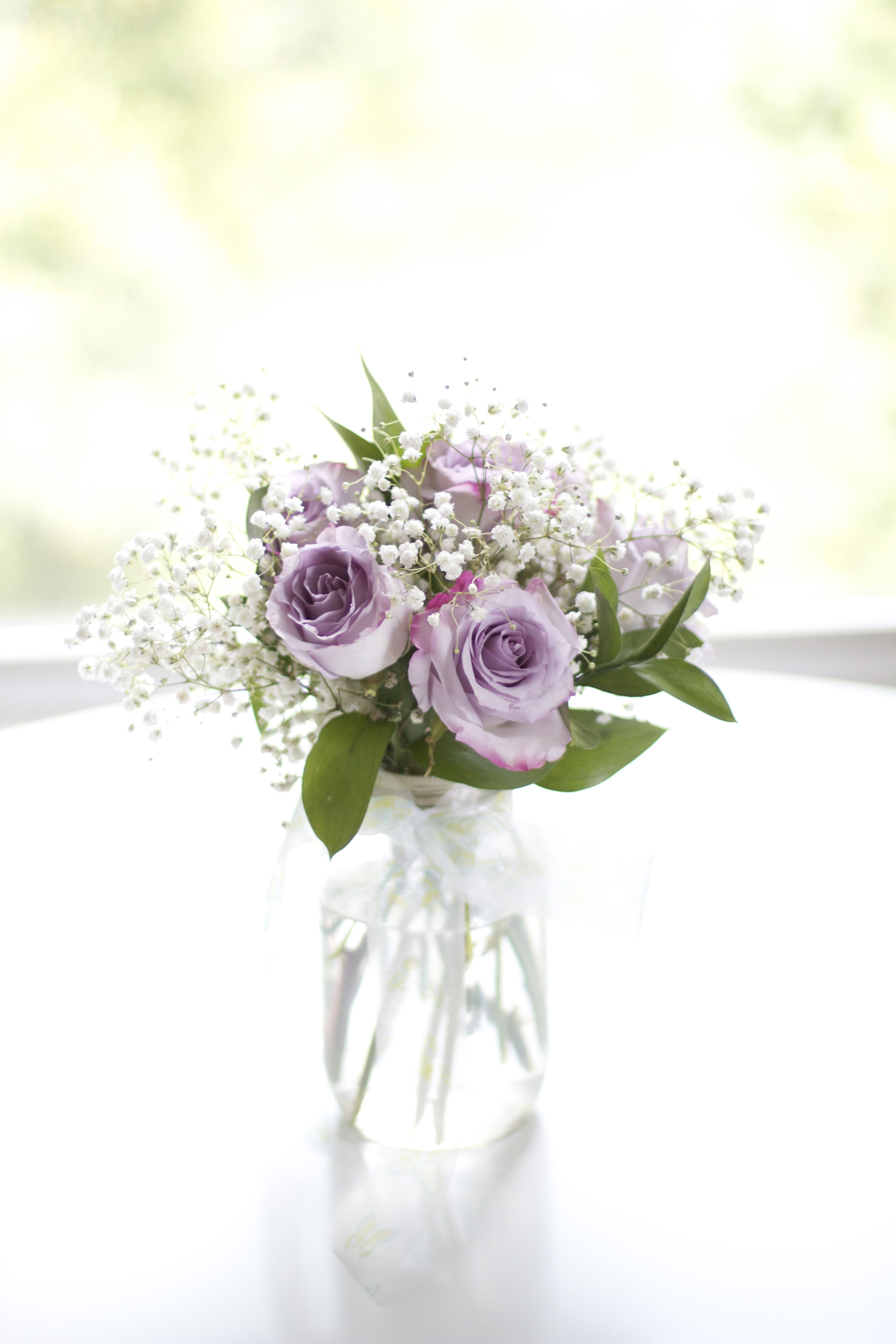 Centerpiece: purple roses in mason jars with greenery & babys breath ...