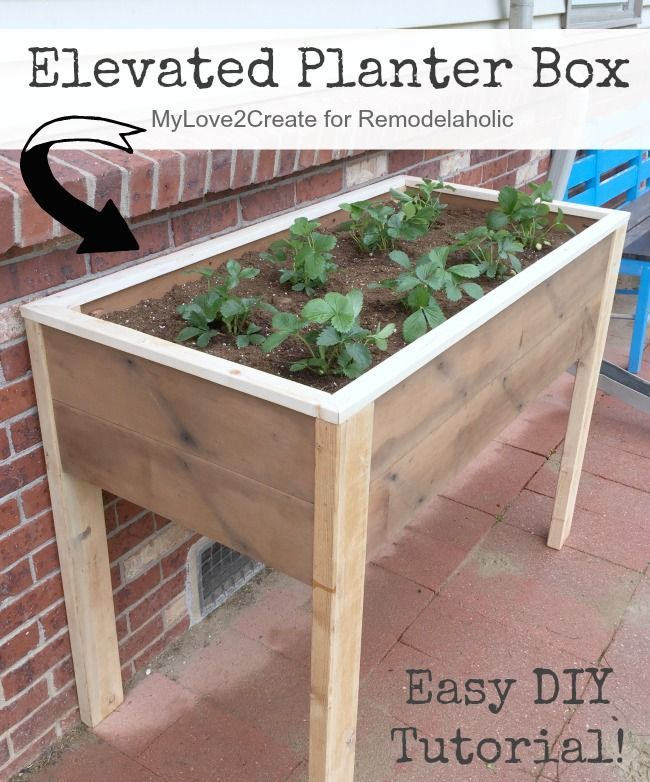 This DIY elevated planter box is raised up off the ground ...