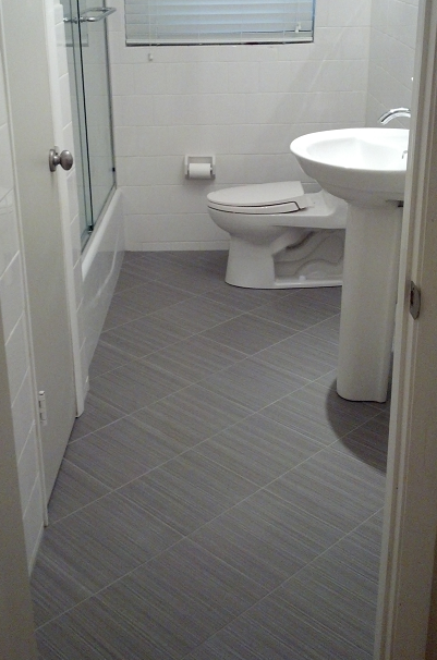 12x12 Daltile Fabrique Unpolished Gris Linen Porcelain Tile Bathroom Floor With A 6x6 White Wainscot In Davis Island Tampa Florida