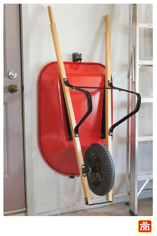 Here S How To Keep Your Garage Organized Install A Wheelbarrow