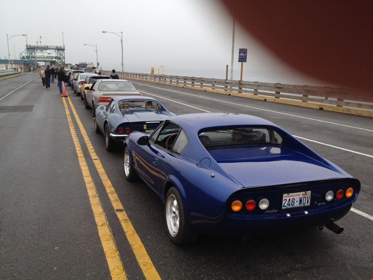 Italia 2 GTC in Ferry line behind Ferrari 246 GT Dino How cool Simpson Design